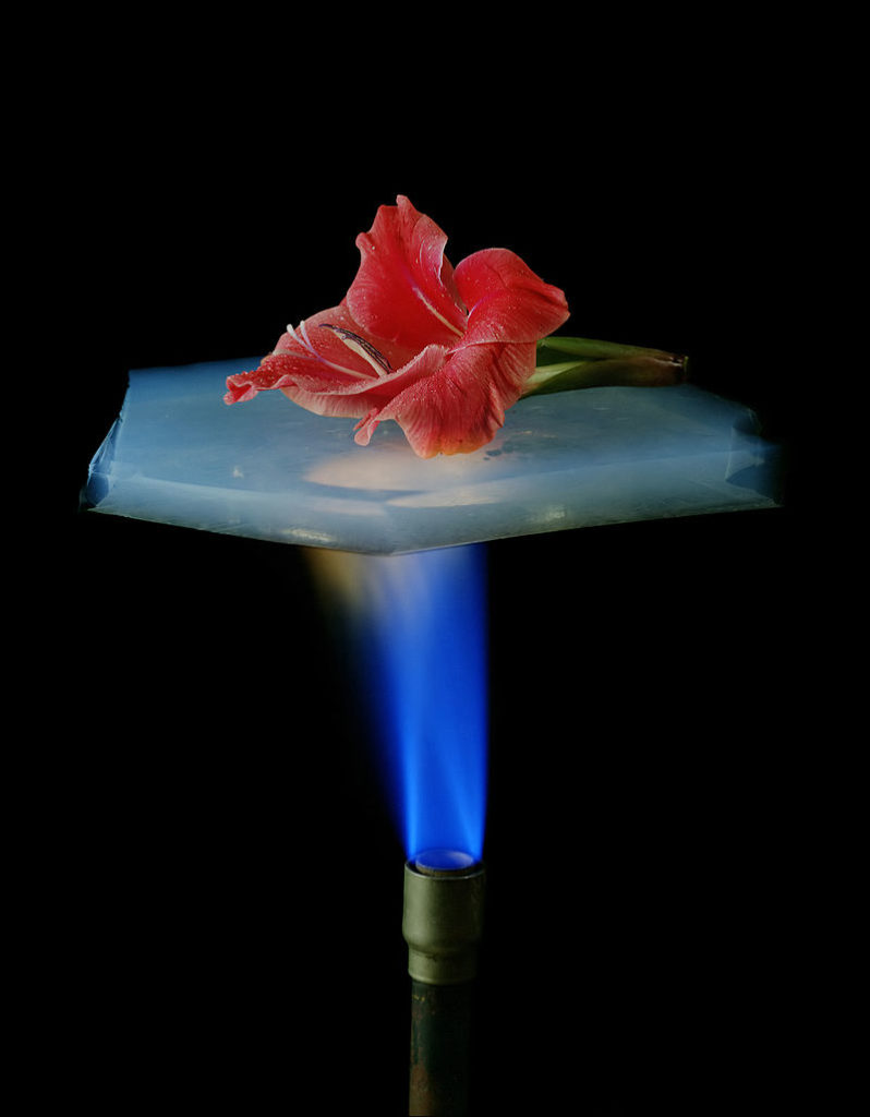 Aerogel suspended over a flame